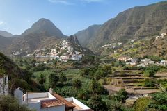 The little village of Hermigua surrounded with mountains La Gomera royalty free stock images