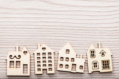 Little village of house wooden figures on a surface in wood Stock Images