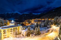 Little village in the night during winter in the alps. Little village in the night during winter with a lot of snow in the alps Stock Photography