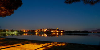 Little village reflecting in a lake by night Royalty Free Stock Images
