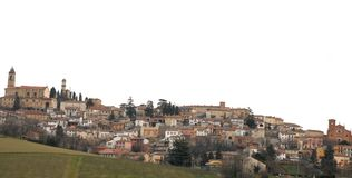 Little village on top of the hill. Photo made at one of the many countries whose houses, buildings, towers and churches are normally located in the top of a hill Royalty Free Stock Images