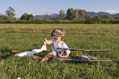 The little villain boy and new RC plane Royalty Free Stock Photos