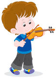 Little violinist. Boy playing his small violin Stock Images