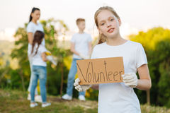Little volunteer helping to plant trees and shrubs in parks Stock Images