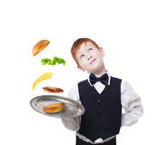 Little waiter stands with tray serving hamburger separate flying toppings Stock Photography
