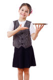 Little waitress standing with tray Stock Photo