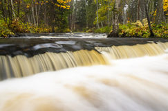 Little waterfall in autumn forest Stock Image