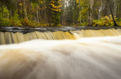 Little waterfall in autumn forest stock photo