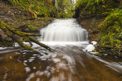 Little waterfall in autumn forest royalty free stock photos