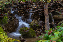 Little Waterfall behind The Rock Royalty Free Stock Photography