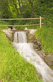 Little waterfall by bridge Royalty Free Stock Photography