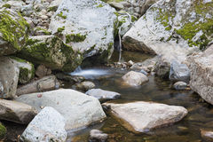 Little Waterfall in a Mountain Brook Royalty Free Stock Photo