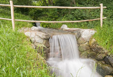 Little waterfall with railing Royalty Free Stock Photo
