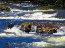 A little waterfall in the river aning the other waterfalls stock photography