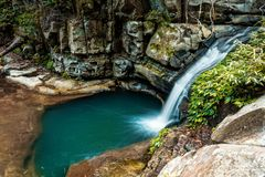 Little waterfall and rock pool stock photos