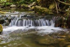 Little waterfall in San Pellegrino in Alpe Stock Photos