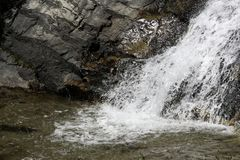 Little waterfall splashing in the brook royalty free stock photos