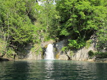 Little waterfall and turquoise Lake, Grenoble Royalty Free Stock Images