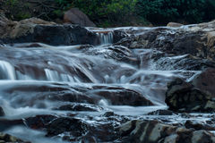 Little Waterfalls. A stream of water flows down the rocks, making tiny waterfalls Stock Images