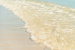 Little wave on the sunny beach Stock Image