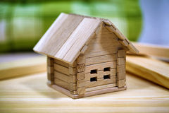 Little weekend house with natural colored toy blocks on white ba Royalty Free Stock Photo