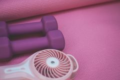 Little Purple Weights and a Portable Fan stock images
