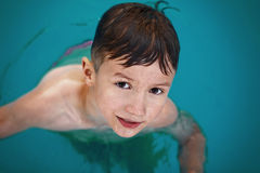 Little wet caucasian boy in pool Royalty Free Stock Image