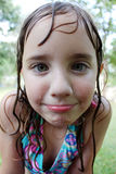 Little Wet Girl. A little girl makes a silly face for the camera while wet from swimming Stock Photography