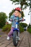 On little wheels. Little girl on her trainer bike Stock Photos