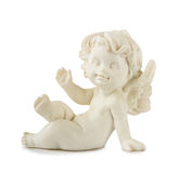 Little White Angel Statue. A little miniature statue of a white angel with wings on a white background Stock Photography