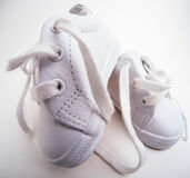 Little White Baby Shoes Stock Photos