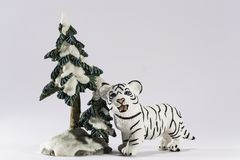 Little White Bengal TigerCub Figurine Under A Tree royalty free stock photo