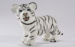 Little White Bengal Tiger Figurine with blue eyes stock photography