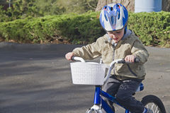 Little white boy learns to ride a bike Stock Photography