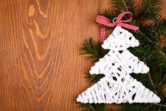 Little white Christmas tree on juniper leaves Royalty Free Stock Image