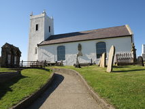 Little white church with path. An old coastal church in ireland with path Royalty Free Stock Images