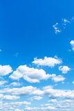 Little white clouds in summer blue sky Stock Images