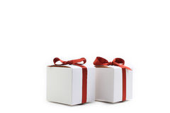 Little white colored present boxes with red ribbons Stock Photo