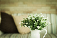 Little white flower in vase on wooden table Royalty Free Stock Photos