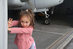 Little white girl in a small private airport Stock Photography