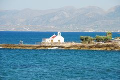 Little white Greek church on the sea on Crete royalty free stock image