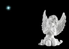 Little white guardian angel with star. Christmas decoration Royalty Free Stock Photos