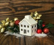 Real Estate Christmas background decoration on dark wooden board. Photo image royalty free stock photo