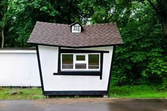 Little white house in the park rainy weather royalty free stock image