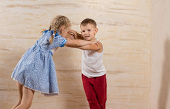 Little White Kids Playing Isolated on Wooden Walls Royalty Free Stock Photography