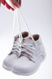 Little white shoes. For baby Stock Photography