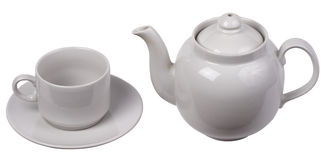 Little white tea cup and a kettle stock images