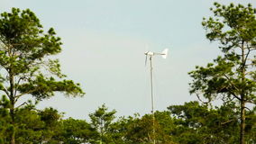 Little wind turbine generating electricity in nature. stock video