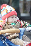 Little winter baby boy in stroller Stock Photo