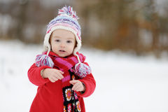 Little winter baby girl. In red coat Royalty Free Stock Images